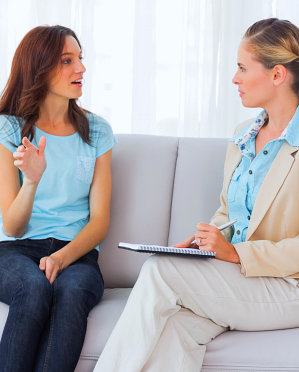 young woman talking to her therapist