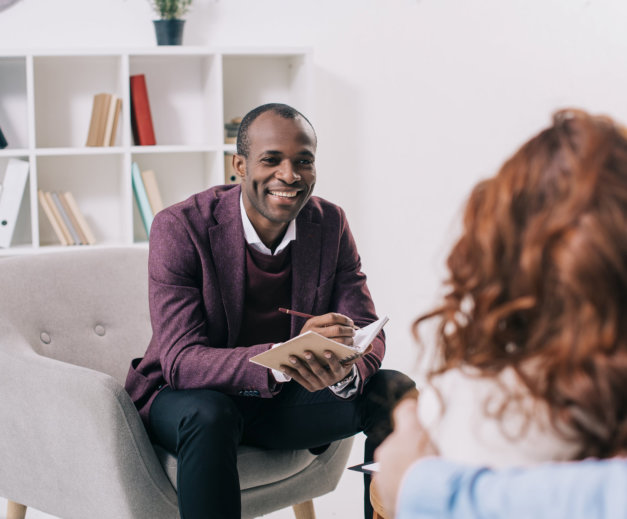 therapist smiling at his client