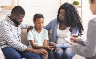 couple letting their daughter talk to her therapist